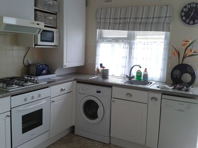 Spacious fully equipped kitchen with dish washer and washing machine