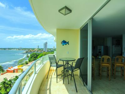 Photo for Lovely condo on quiet beach only 40 minutes from the City