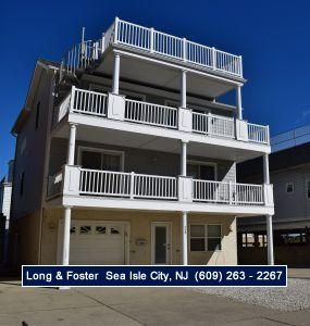 Photo for Beachblock townhouse. Ocean Views!!!!  Only steps to the beach and promenade. Close to center of town, shopping and restaurants.