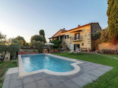 Photo for Wonderful villa immersed in the Tuscan greenery, with private panoramic pool