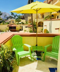 Private patio and seating areas, overlooking pool