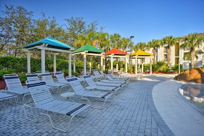 There's plenty of space to relax poolside at this vacation rental apartment.
