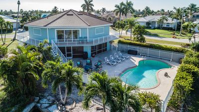 Photo for Spacious 5 BR Waterfront Home w/ Pool, Bikes, Beach Equipment.  A perfect Oasis!