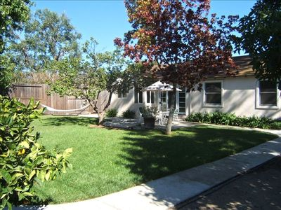 Relax in the private enclosed back yard complete with hammock, BBQ and patio set