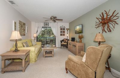 Photo for Beautifully updated, bright and cheery 2nd story condo near pool & beach access- SC261