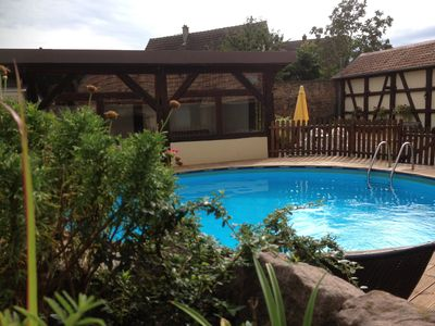 Photo for Cozy cottage between the Alsatian vineyards and the Vosges with swimming pool