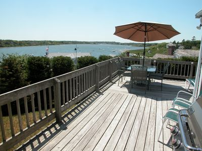 Wraparound deck has spectacular panoramic water views of the Oyster Pond.