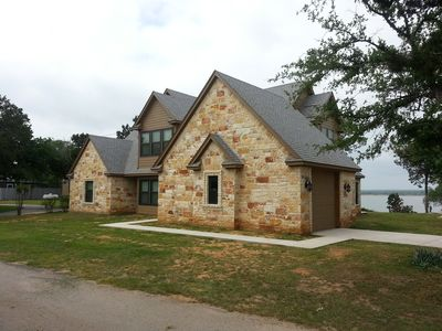 Sunset Retreat overlooking Lake Whitney with accommodations for up to 12 guests.