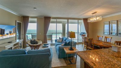 Photo for Spectacular Beach Front Condo w/2 Heated Pools & Free Beach Chairs & Umbrella!