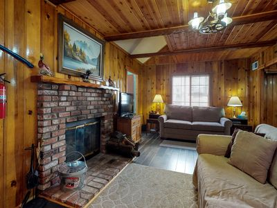 Photo for Cozy cabin with fireplace & loft - nearby skiing and beach access