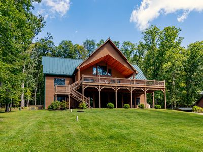 Photo for Split lakefront, game tables, private dock, hot tub, 5 master suites!