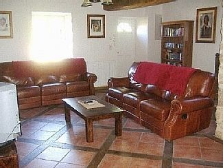 Spacious living room with comfortable settees