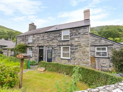 Photo for ARTHUR'S COTTAGE, pet friendly, with open fire in Tywyn, Ref 974436