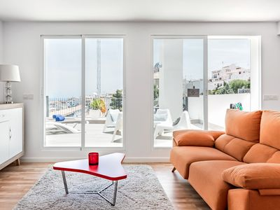 Photo for Stunning sea view up to 4pp, WiFi, A/A, Parking, bike station, terrace & pool