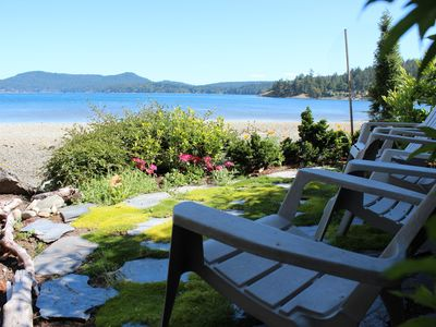 Photo for Private cottage with hot tub in lush garden setting on beautiful waterfront