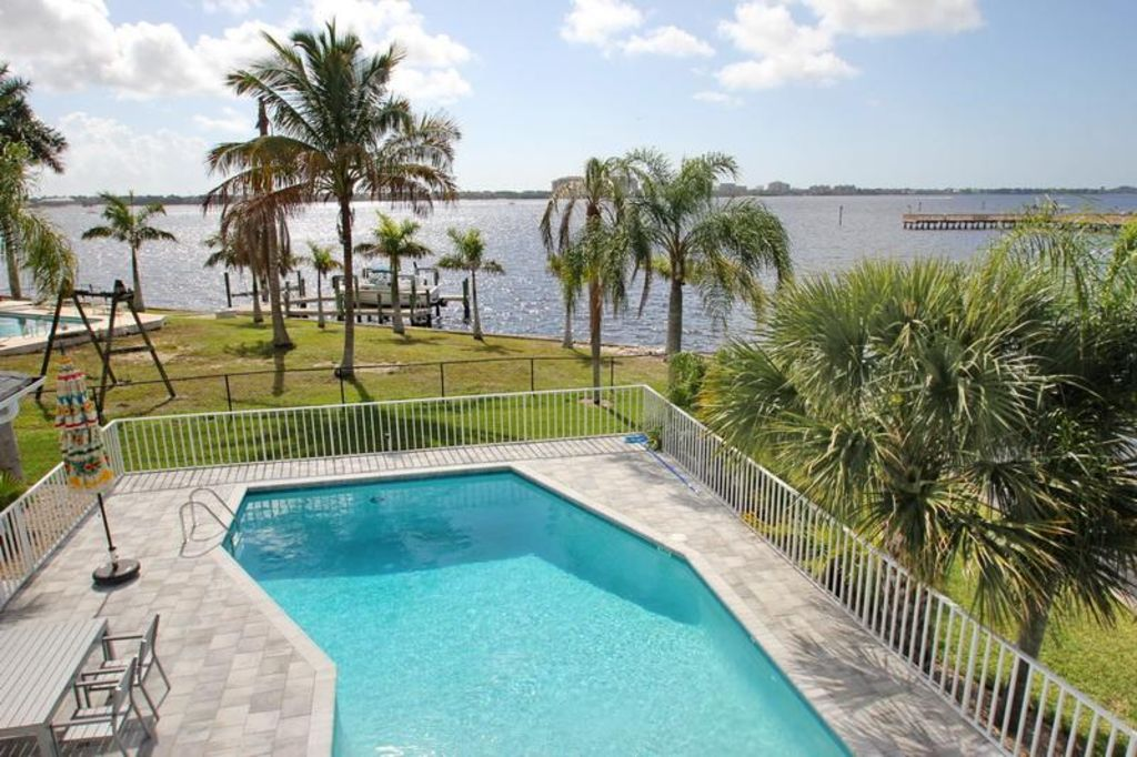 This luxury pool villa is located directly on the river in a fantastic location