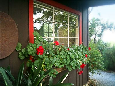 Rustic cottage atmosphere with elegant touches of professional landscape design.