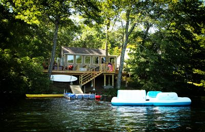 View of cottage from lake(Raft pictured may not be available)
