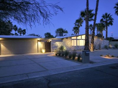 Front - Desert Landscaping - Palm trees envelop the property.