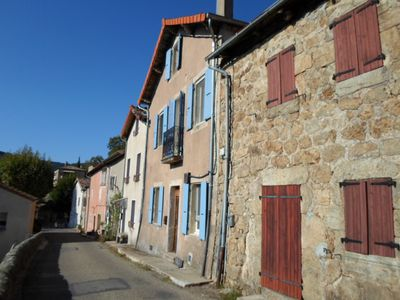Our house with blue shutters and Juliet balcony. The road leads to the village.