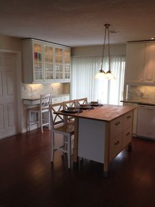 Kitchen/dining area with additional seating available.
