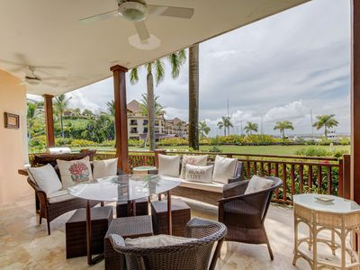 Photo for Tropical waterfront elegance w/ furnished patio plus shared pools, gym, tennis
