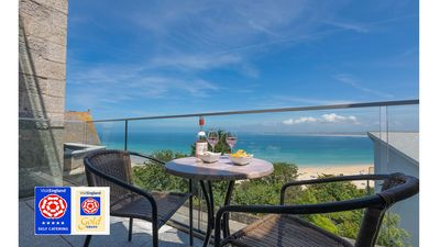 Photo for Luxurious 5* Beachfront apartment, free wifi and sky tv