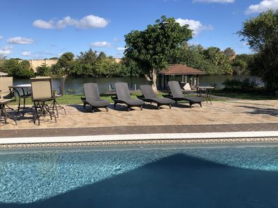 Photo for Relaxing Waterfront Palm Beach - Private Boat Dock, Pool, Hot Tub, Home Theater