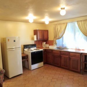 Microwave, coffee maker, stove, toaster refrigerator, pans, dishes & silverware
