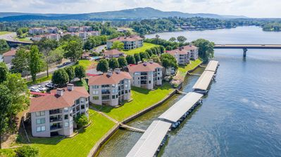 Photo for Gorgeous waterfront condo, professionally decorated.  Gated, with boat slip.