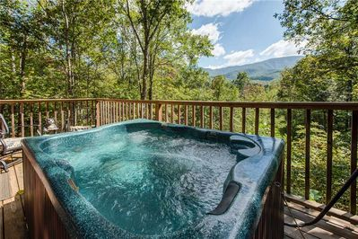 A hot tub with a view - Luxuriate in the deck's hot tub early in the morning and watch the mist rise from the mountains. Then return at night to soak beneath the stars—so romantic!