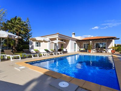 Photo for This spacious detached villa, sits within its own mature, private, gated gardens, in the quiet resid