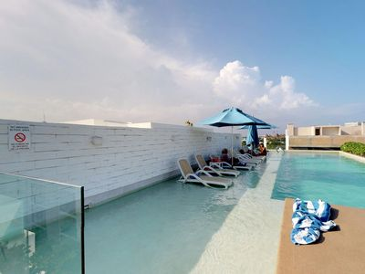 Photo for NEW LISTING! Modern apartment w/balcony, shared rooftop pool & spa-walk to beach