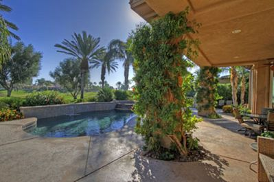 Enjoy the Beautiful Palms while listening to music under the covered deck area!