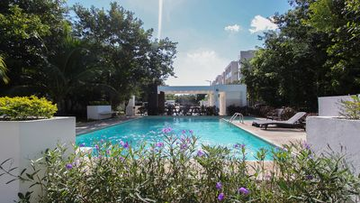 Photo for NEW LISTING! Breezy condo w/ patio & shared pool, gym & lounge- 3 miles to beach