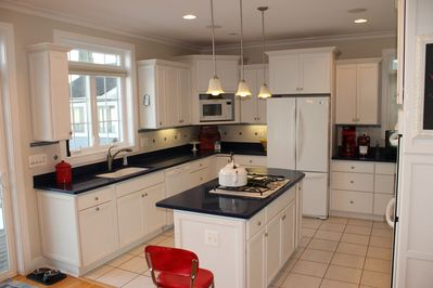 Large kitchen with quartz counters.  Beautiful and functional.