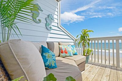 Private oceanfront deck with hotel style seating.