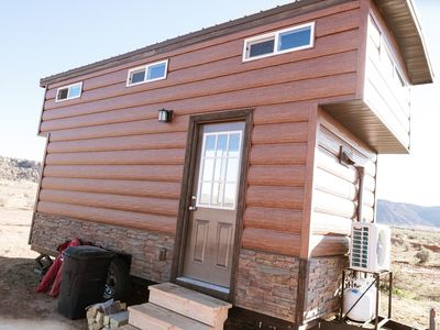Photo for beautiful log cabin tiny home located on 40 acres surrounded by red rock canyons