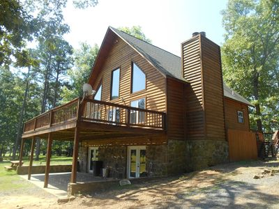NE Exterior of Joe's Cabin showing large patio and open deck