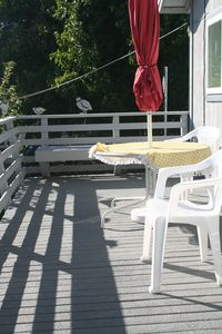 Refurbished deck with cushioned seating table with umbrella