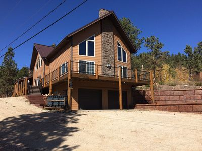 Photo for Great Location 5BR Cabin w/ Wrap Around Deck, Hot Tub, and Newly Decorated!