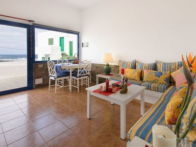 Photo for Vacation Apartment on the Beach with Wi-Fi, Patio & Magnificent View