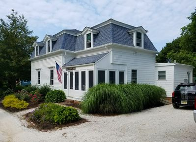 Walk to town and the harbor from this historic home