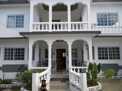 Front of Tropical Breeze 6 bedroom villa with colonial style pillars.