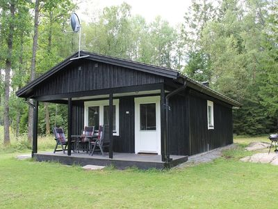 Photo for Modern functional cottage at the lake by boat and private pier, quiet location