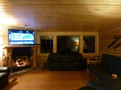 "Living Room with WOOD (not gas) fireplace, 55"" TV, 3 couches"
