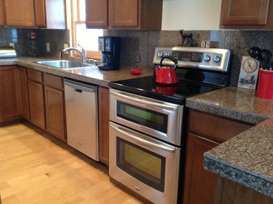 Kitchen- totally remodeled! New cabinets, granite, stainless steel - stocked!