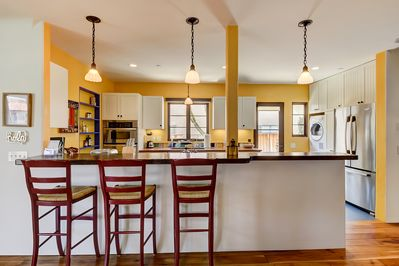 Bar seating to kitchen allows for more convenient dining while cooking