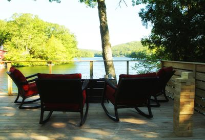 View of Lake from the cushioned rocking chairs.  Fire table and Giant Jenga