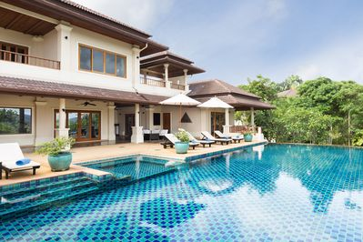 Swimming pool and villa in daytime